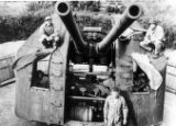 100mm dual barrel gun near Omura