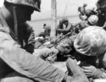 A Marine gives first aid to a wounded Marine on Tarawa.